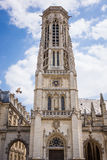 St Germain church, Paris. St Germain church tower Paris with blue sky, clouds and bird Stock Photo