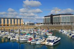 St. Hellier Marina, Jersey. The marina in St. Hellier, the capital of Jersey, with modern apartment blocks under construction Stock Image