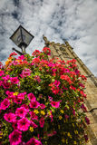 St Ia's Church clock tower and flowers Stock Photos