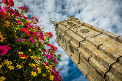 St Ias Church clock tower and flowers Stock Photography