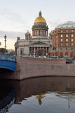St. Isaac`s Cathedral and the Astoria hotel Stock Photos
