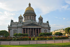 St. Isaac's Cathedral on a background of red roses on the square Royalty Free Stock Photo