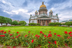 St. Isaac`s Cathedral in cloudy weather with flowers Royalty Free Stock Photos