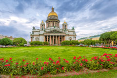 St. Isaac`s Cathedral in cloudy weather with flowers Stock Image