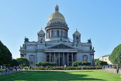 St. Isaac's Cathedral, green lawn and red roses on the square br Stock Image