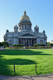 St. Isaac's Cathedral, green lawn and red roses on the square br Stock Photo