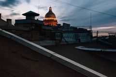 St. Isaac`s Cathedral in St Petersburg, view from the roof of the city at sunset stock photo
