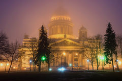 St. Isaac`s Cathedral in night illumination on a misty spring evening. The view from Senate square. Saint Petersburg Royalty Free Stock Photography