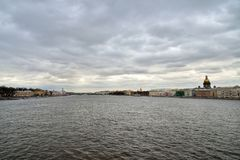St. Isaac's Cathedral and the Palace bridge across the Neva rive Stock Images