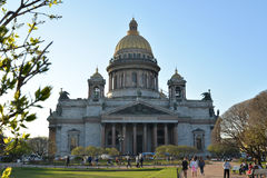 St. Isaac's Cathedral and walking people on a Sunny day Stock Photo