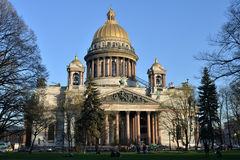 St. Isaac's Cathedral and walking people on a Sunny day. In St. Petersburg Royalty Free Stock Photos