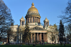 St. Isaac`s Cathedral and walking people on a Sunny day Royalty Free Stock Photos