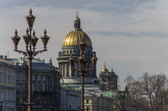 St. Isaac's Cathedral and lights on Palace (Dvortsovaya) square. Stock Photos