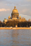 St. Isaac& x27;s Cathedral in the rays of the setting sun. View from the Admiralty embankment. Saint Petersburg Stock Images