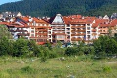 St. Ivan Rilski hotel and summer mountains panorama in bulgarian ski resort Bansko Royalty Free Stock Images