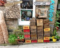 St Ives, Cornwall, UK - April 13 2018: Large selection of novelt. Y wooden boxes with fictitious and genuine company names, outside a tourist shop or store Royalty Free Stock Image