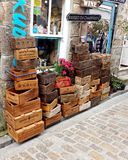 St Ives, Cornwall, UK - April 13 2018: Large selection of novelt. Y wooden boxes with fictitious and genuine company names, outside a tourist shop or store Stock Photos