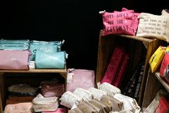 St Ives, Cornwall, UK - April 13 2018: Selection of small bags and other accessories with messages on, in a ladies shop.  Stock Images