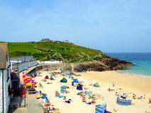 St. Ives, Cornwall. St. Ives, Cornwall, UK. June 18, 201O. The landmark of Portgwidden Porth Gwidden beach, with the old fisherman`s chapel in the background at Royalty Free Stock Images