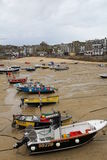 St Ives, Cornwall. UK - 18th October, 2016: Boats on the sands of St Ives harbour when the tide is out. These small boats are still used for fishing in the Royalty Free Stock Images