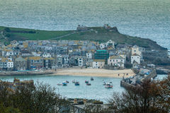 St Ives cornwall. View of St ives cornwall looking at the beach and harbour with the village in the background boats moored in harbour stock images