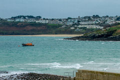 St Ives cornwall. View of St ives cornwall looking at the beach and harbour with the village in the background boats moored in harbour stock photography
