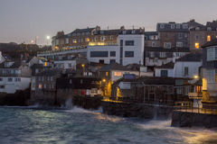 St Ives cornwall. View of St ives cornwall looking at the beach and harbour with the village in the background boats moored in harbour, taken at night royalty free stock image