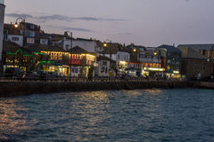 St Ives cornwall. View of St ives cornwall looking at the beach and harbour with the village in the background boats moored in harbour, taken at night royalty free stock photos