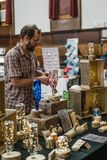 Man on an art and antique flea market stock image