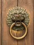 St Jacob Monastery entrance Regensburg. Lion head knocker on the entrance door of St Jacob Monastery in the medieval town of Regensburg, Bavaria, Germany Stock Image
