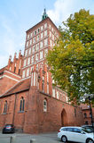 St. Jacobs Church in Olsztyn (Poland). St. Jacobs Church was built in the 2nd half of the 14th century in the Gothic style. Church tower is 63 metres high. Since Royalty Free Stock Image