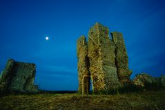 Atmospheric church ruins. St James church ruins near Bawsey, Kings Lynn, Norfolk, Uk taken before dawn royalty free stock image