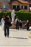 St. James Parish Church of Medjugorje. MEDJUGORJE, BOSNIA AND HERZEGOVINA - MAY 18, 2013: Unidentified Pilgrims praying before the image of the Virgin Mary in Royalty Free Stock Photo