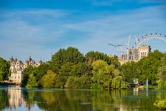 St James`s Park in London with London Eye in the background. Beautiful view St James`s Park in London with London Eye in the background on a beautiful summer royalty free stock image