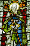 St John the Baptist Stained Glass Window. Historic Victorian stained glass window showing Saint John the Baptist carrying his long staff.  On public display over Stock Image