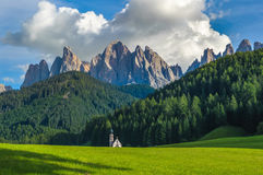 St. John church in front of the Odle mountains, Dolomites Stock Image