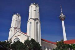St John e Kuala Lumpur Tower Imagens de Stock