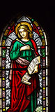St John The Evangelist. Victorian stained glass window depicting the evangelist St John Stock Photography