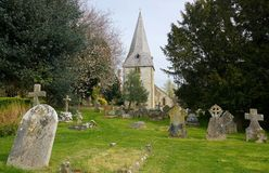 St John the Evangelist Church, Bury, Sussex, UK. St John's church is perched on a bank of high ground close to the River Arun in the village of Bury royalty free stock photo