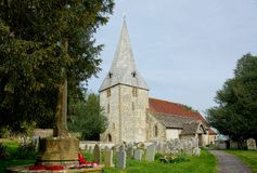 St John the Evangelist Church, Bury, Sussex, UK. St John's church is perched on a bank of high ground close to the River Arun in the village of royalty free stock image