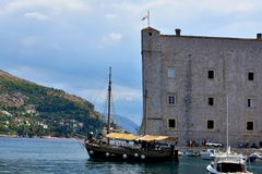 Fort and old sailboat in Dubrovnik. The St. John Fortress Croatian: Sveti Ivan, often called Mulo Tower, is a complex monumental building on the southeastern Royalty Free Stock Photos