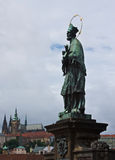 St. John of Nepomuk and Prague Castle Royalty Free Stock Photos