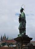 St. John of Nepomuk and Prague Castle Royalty Free Stock Photos