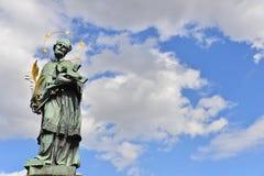 St John Nepomuk Statue on Charles Bridge. Prague, statue, clouds, sky, blue sky, st john nepomuk, cloudy sky, czech republic, john nepomuk, john of nepomuk Stock Photo