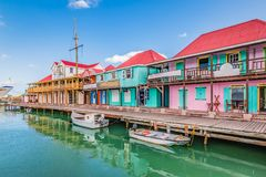 St John`s, Antigua. Colorful buildings at the cruise port. Bright image with colorful houses and shops along the waterfront at the port of St John`s, Antigua royalty free stock images