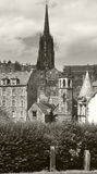 St. John´s church tower and antique buildings. Edinburgh. UK Royalty Free Stock Photography