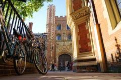 St John's College, Cambridge, England. CAMBRIDGE, UK - SEPTEMBER 27 2015: Pedestrians pass the entrance gate of St John's College, Cambridge, England Royalty Free Stock Image