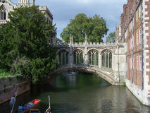 St John`s College in Cambridge. CAMBRIDGE, UK - CIRCA AUGUST 2007: St John`s College in Cambridge with bridge of sighs over river Cam and unidentified people Royalty Free Stock Photography