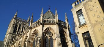 St John's College Chapel, Cambridge, England. Panoramic perspective view of the chapel of St John's College, Cambridge University, and an adjacent historic Royalty Free Stock Images