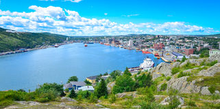 St John's Harbour in Newfoundland Canada. Panoramic view, Warm summer day in August. Panoramic views with bight blue summer day sky with puffy clouds over the stock image